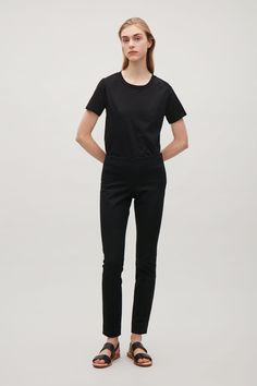 COS image 5 of Slim-fit trousers in Black
