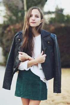 Emerald green suede skirt paired perfectly with this leather jacket. A | More outfits like this on the Stylekick app! Download at http://app.stylekick.com