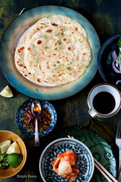 Ok now back to today's recipe; today I am sharing a recipe of Green Onion Pancake, one of my most loved yummy. This recipe is from the cookb...