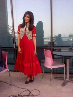 Red Anarkali with a jacket.