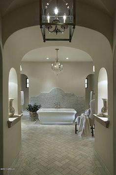 Mediterranean Master Bathroom with Freestanding, Pendant Light, Crema Marfil Marble 1x3 Herringbone Mosaic Tile Polished