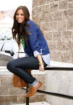 blue sweater over an oxford shirt or light denim shirt, dark skinny jeans, brown oxfords