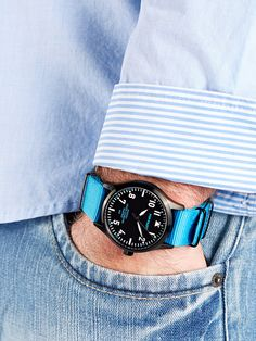 POP-PILOT® watches  DXB with a neon blue nato strap an a black casing