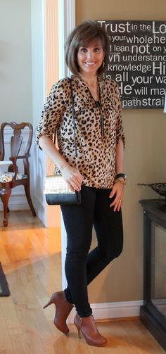 Leopard print shirt, black jeans, black and gold purse. Could wear black boots instead.