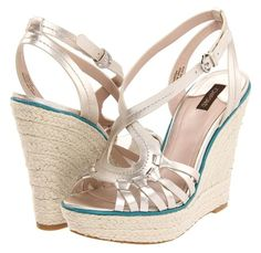 For purchase information, visit http://photos.yournextshoes.com/2012/05/joan-david-new-styles-may-2012/joan-david-dreena-alba-metallic/