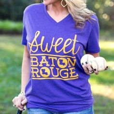 Baton Rouge-based T-Shirt company, we have so much love for our great city! Show your Baton Rouge pride with our Sweet Baton Rouge® heather purple hometown v!