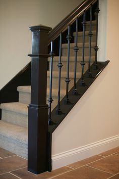Beautiful (Res UPGRADED STAIR SYSTEM   We Showcase An Upgraded Stain Grade Handrail  Newel Plus Skirt Paired Beautifully With Wrought Iron Pickets.