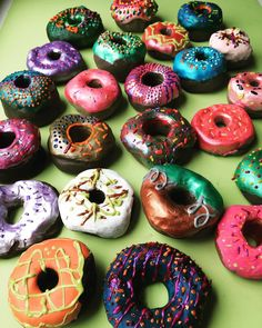 Inspired by artist @peter_anton_ Year 6 glazed their clay doughnuts with acrylic and pearl paint and decorated with puffy paint sprinkles  #kidsart #kidsclay #kidsartwork #doughnuts #donuts #foodart #claydonut #claydoughnut #donutart #doughnutart