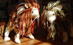 felt lions with yarn manes