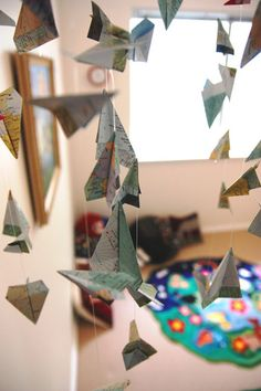 Paper airplane mobile made from maps