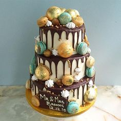 Anges du Sucre's 3 tier chocolate, vanilla and red velvet sponge cake with pastel blue cookies & cream salted caramel and vanilla macarons with gold leaf ~ we ❤ this! moncheribridals.com
