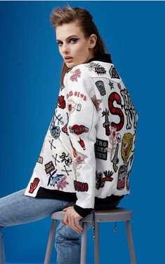 Make your own version of Sandra Mansour's hero piece with her unique collection of silk patches, slogans and initials. Choose from a black or white satin base and build your bespoke bomber exactly as you wish.