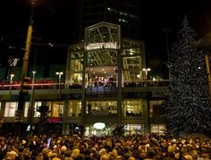 "Westlake Center Tree Lighting. In ""Christmas Bells are Ringing"" by Lesley Ann McDaniel, Shelby and Chris watch the Seattle tree lighting from the ""stage"", which is the balcony of Westlake Center Mall."