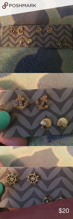 BOGO 1/2 OFF Nautical stud earring set Set of 4 pairs of nautical themed earrings: bedazzled anchor (all gemstones in-tact), seashells, ship steering wheels, and striped anchors, brand new & never worn, super cute and in great condition ✨make an offer!✨ feel free to comment if you have any questions! 😊 ‼️ALL LISTINGS BUY ONE GET ONE HALF OFF❗️(of the two items, the less expensive item will be half off) just make a bundle and I'll re-price‼️ Jewelry Earrings