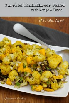 If you're looking for a show stopping side dish, then look no further than this curried cauliflower salad with mango and dates. It combines the deep flavors of Indian and Middle Eastern with the humble cauliflower for a dish that's packed with seasoning and totally AIP. #adventuresinpartaking #aip #aipindian #aipsalad