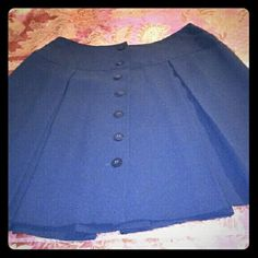 Black pleated skirt Beautiful black knee high skirt.  Its has seven buttons in the front, 100% polyester and fully lined.  Made in the USA and dry cleaning only. Ann Taylor Loft Skirts Mini