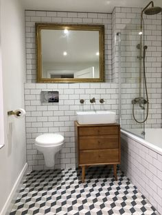 Your daily dose of Inspiration: A monochrome backdrop certainly brings out the splendor of the wood furniture in this stylish bathroom design Belfast Sink Bathroom, Bathroom Sink Units, Bathroom Toilets, Belfast Sink Vanity Unit, Bathroom Layout, Rustic Bathroom Designs, Bathroom Interior Design, Modern Bathroom, Small Bathroom