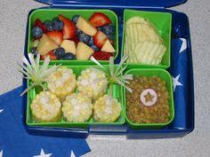 4th of July Vegan Lunch Box.  (corn, radish stars, green onion fireworks, lentil bean salad, baked potato chips).