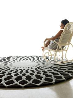 Trama van GAN: rond tapijt met kanteffect. Ontwerp: Odos Design.