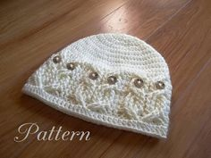 """This listing is for an Instant Download CROCHET PATTERN ONLY, and not the actual hat shown. It's a Hoot!,, A beanie style hat done in beautiful cables to create an owl pattern all around the brim. The """"owls"""" eyes are buttons which are attached during the actual crochet work a"""