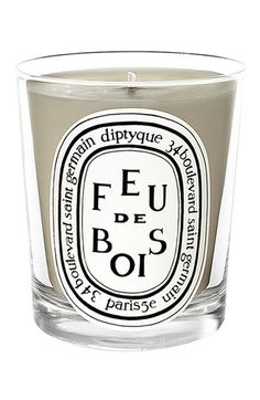 Diptyque Feu de Bois (Wood Fire) Candle is a very sophisticated blend of rare wood essences that evoke the characteristic fragrance of a wood-burning fireplace on a long winter day. A Diptyque top seller. Diptyque Candles, Candles And Candleholders, Mini Candles, Scented Candles, Round Candles, Outdoor Candles, Wax Candles, Grey Candles, Scented Wax