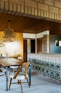 BRICK HOUSE - i like the brick ceilings, the wood wall paneling, the unusual lamp, he side board that is made of bricks in unusual design.
