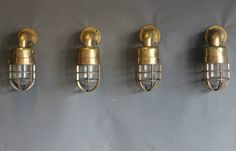 Love this vintage set of four brass garden wall lights from Norfolk Decorative Antiques.