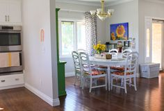 whatever blog, love the table & chairs and the green hutch and the photos on the wall!