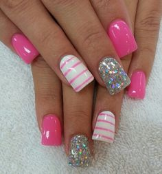 Hot pink nails with strips and glitter.