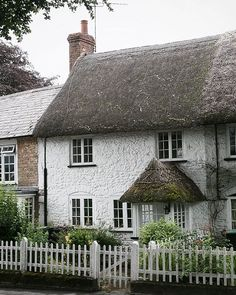 thatched cottage, somewhere in the english countryside