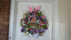 So pretty!!  Easter Bunny Rabbit Ears, Paws,  Basket Deco Mesh Spring Wreath https://www.etsy.com/listing/270921130/bunny-rabbit-ears-paws-basket-easter
