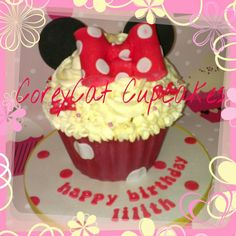 Minnie mouse themed giant cupcake, with pink spotty sponge inside, and a white chocolate 'case'  Lilith really enjoyed this cake :)