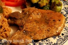 Skillet seared pork chops finished in a pan gravy.