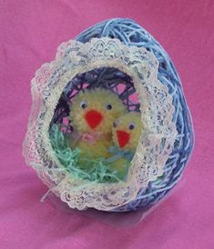 Yarn or colored string, balloons, glue, a bit of lace and any desired Easter Trims.  These are sweet and can be made large enough to act as an Easter basket, you just need BIG balloons!  But you can make smaller ones with water balloons as well!