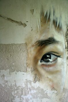 *Matt Adnate*  Would be a great idea to paint something toned and detailed onto a crumbling/decaying srface