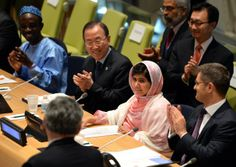 Pakistani student Malala Yousafzai, second from right, is greeted by United Nations Secretary General Ban Ki-Moon, second from left, Vuk Jeremic, right, president of the U.N. General Assembly, and Gordon Brown, left, back to camera, United Nations special envoy for global education on July 12 at U.N. headquarters in New York. Yousafzai became a public figure after she was shot by the Taliban while travelling to school last year in Pakistan — targeted because of her committed campaigning for…