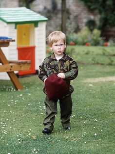 FORESHADOWING HARRY:  Almost-2-year-old Prince Harry looks right at home in a miniature army uniform – just as he did nearly two decades later. ~ Photo by Tim Graham/Getty.