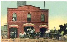 "First brick fire station built in Lufkin about 1902. Located on Cotton (Calder) Square. City Hall housed on top floor. A small part of the ""Stand Pipe"" ( town water tower) can be seen above and at rear of the building."