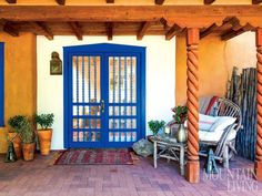 """Designer Susan Stella mixed a custom color for her New Mexico home's front doors. """"I've always been inspired by the different blues used in Pueblo architecture,"""" she says. """"They can range from turquoise to deep, rich indigos."""" PHOTO BY Audrey Hall"""