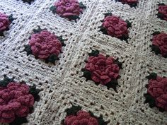 """Crochet a rose granny square afghan. Pinner says:- """"I still have the one my Nana Hartshorn made me years ago!"""" ** such a beautiful layout!- you will have a part of her work with you forever! :-)..*"""