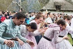 Members of the Nyirseg Dance Group, wearing folk costumes, run away from young men who try to pour water on them from buckets as they perform an Easter folk tradition in the Sosto Village Museum in Nyiregyhaza, Hungary, Easter Monday. According to an old Hungarian tradition, young men pour water on young women, who in exchange present their sprinklers with colored eggs.