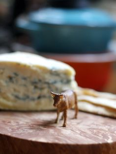 Toy Cows and Goats: A Playful Yet Informative Cheese Tray Decoration