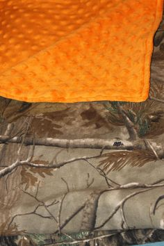Real tree camo blanket. $36.00, via Etsy.