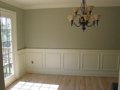 I like the white wainscoting with neutral color above the chair rail and next to white painted French doors
