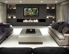 Love this! 60inch flat screen over fireplace in open room! More idea's for babe (living room/man cave).