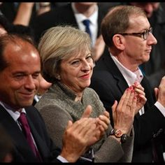 PM Theresa May listens to Philip Hammond on Day 2 of the Conservative Party Conference