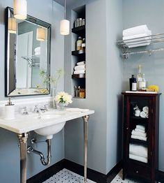 If you're wondering how to decorate a bathroom, you'll love these small bathroom design ideas. Create a stylish bathroom with big impact with our easy small bathroom decorating ideas. Decor, Bathroom Organization, Shelves, Home, Small Bathroom, Walnut Cabinets, Bathroom Design, Bathroom Decor, Vanity Design