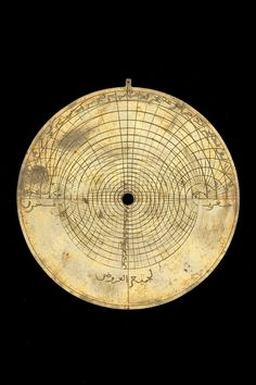 Date:	14th century. Place:	North Africa. Material:	Brass. Astrolabe Catalogue Inventory no.	53556. The back contains 5 scales of the following types: Altitude; Zodiacal signs; Calendar; Unequal hours; Shadow square. The zodiac on the rete is labelled: الحمل , الثور , الجوزا , السرطان , الاسد , السنبله , الميزان , العقرب , القوس , الجدي , الدلو , الحوت .