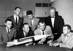 The Original 7 Mercury Astronauts are pictured around a table admiring an Atlas model. The Mercury 7 astronauts were introduced to the American public in April 1959. (Photo: NASA via CNP/Newscom)