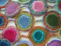Blanket stitch around fabric center, then single crochet 2 or 3 rows. Attach with chain.